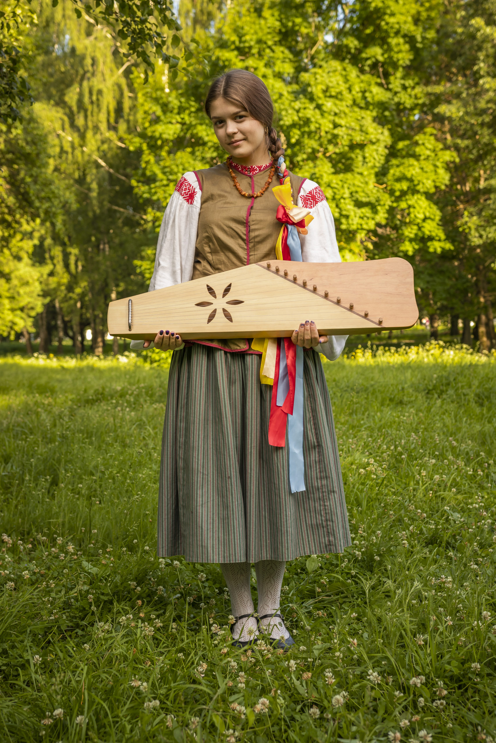 Kokle or historically kokles (kūkles) is a Latvian plucked string instrument